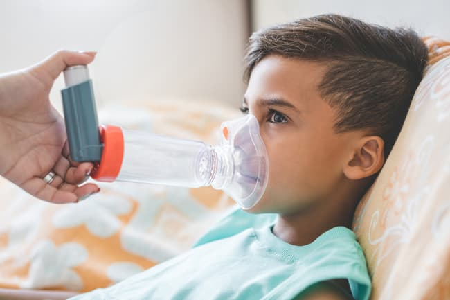 photo of child receiving breathing treatment
