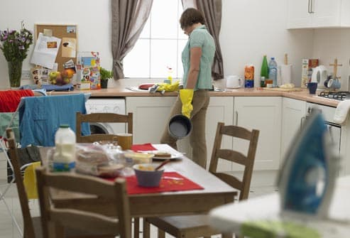 Overwhelmed woman in kitchen