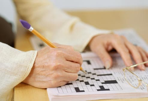 woman doing a crossword puzzle
