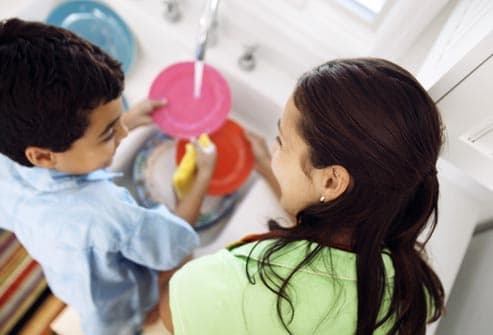 mother and son washing dishes