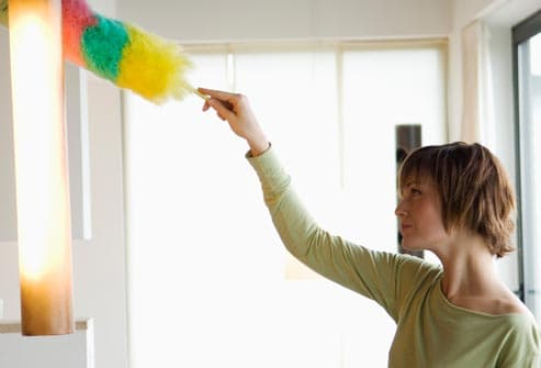 woman dusting