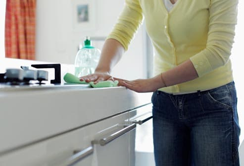 woman cleaning counter