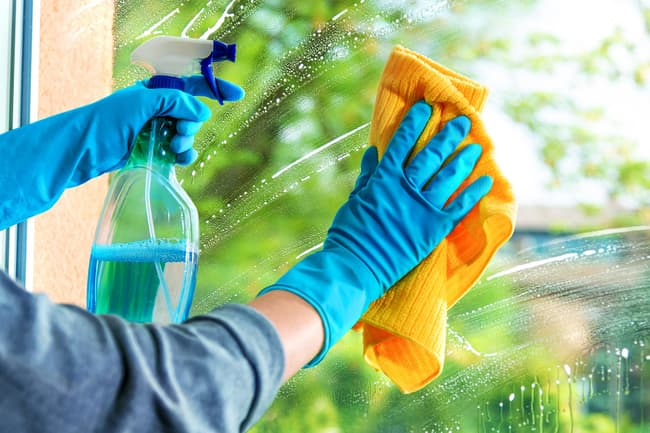 photo of cleaning glass in home