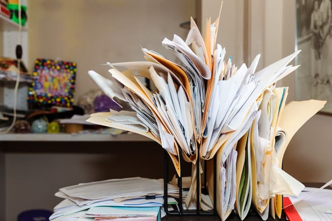 photo of cluttered office papers