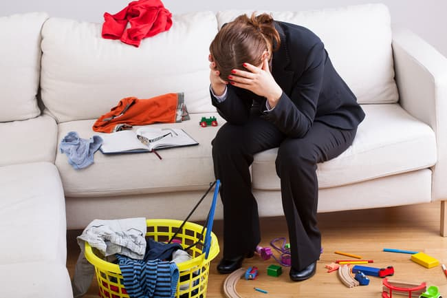 photo of stressed woman in messy house