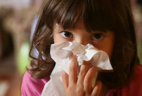 Little Girl with Cold Blowing Nose