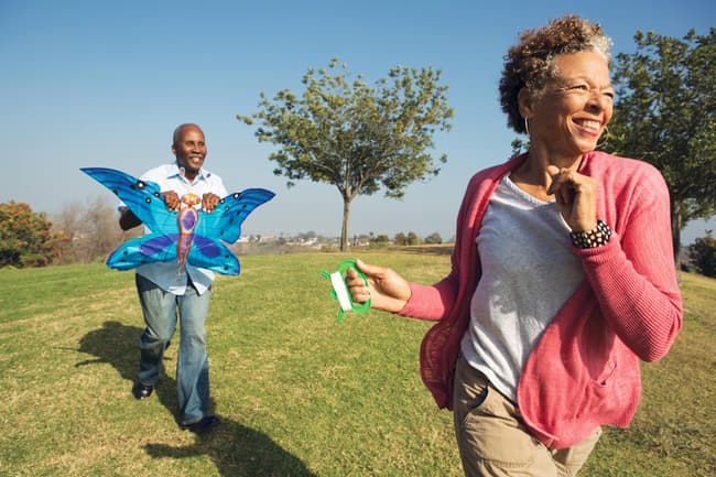 photo of mature couple flying kite