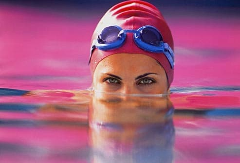 woman wearing swim cap in pool
