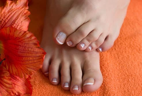 Photo of woman's feet with pedicure