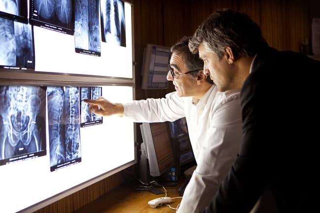 doctor examining xrays with patient