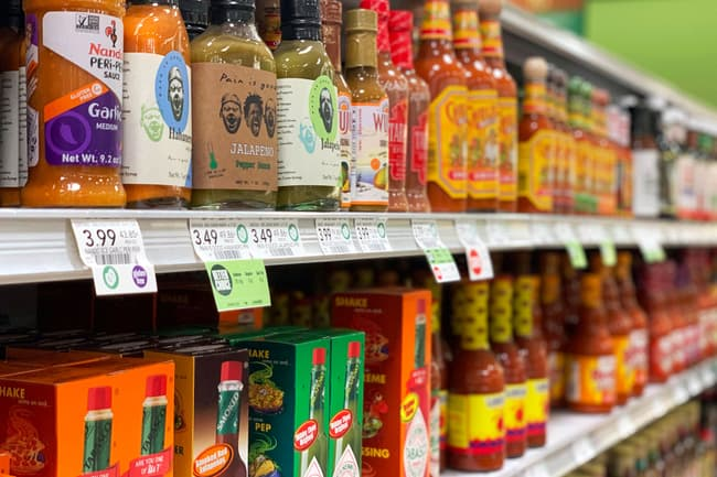 photo of condiments on grocery store shelves