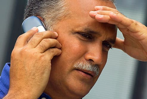 Worried looking man on cell phone