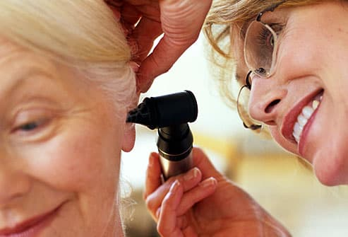 Woman having ear examined