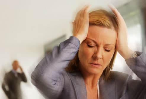 Woman experiencing dizziness