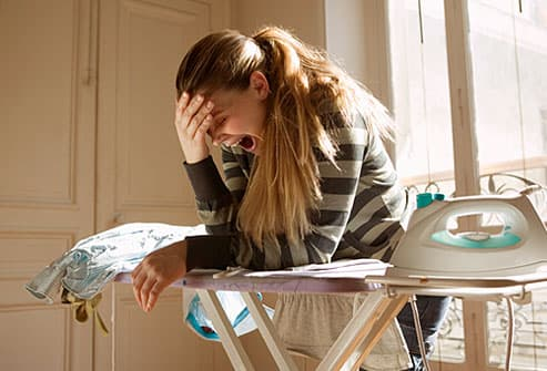 Young woman experiencing fatigue