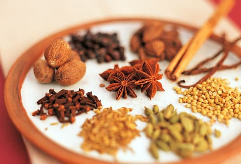 Colorful assortment of exotic spices on plate