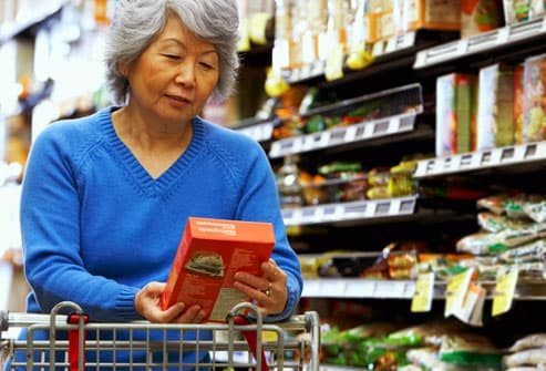 Senior woman shopping for whole grain products