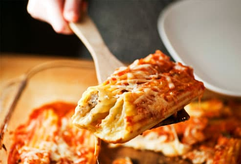 Lasagna being served from large pan