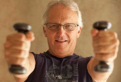 man using hand weights