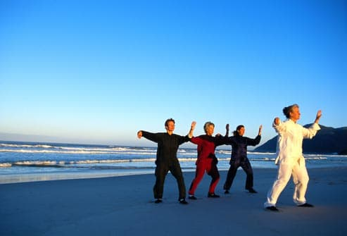 tai chi class on beach
