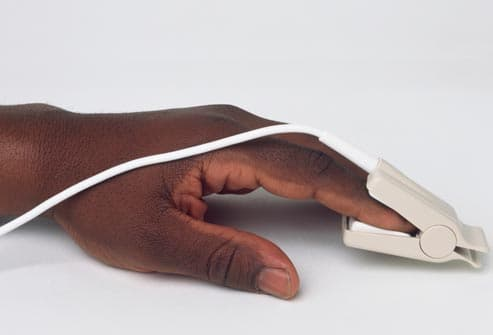 hand wearing pulse oximeter