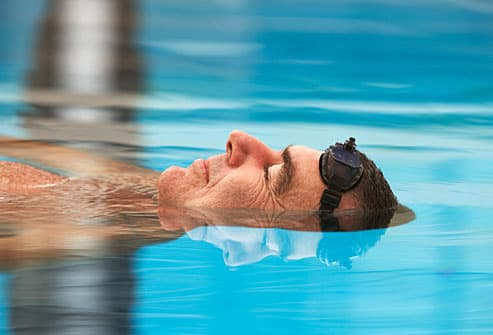 Mature man swimming