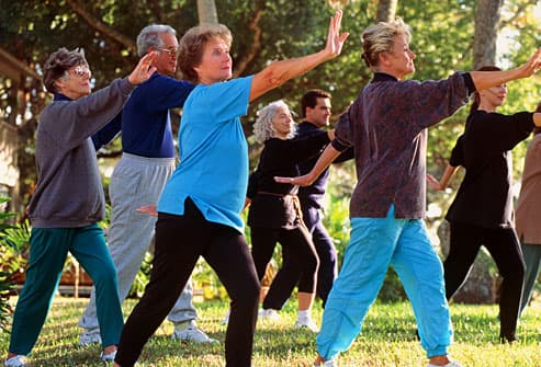 Group of seniors doing tai chi