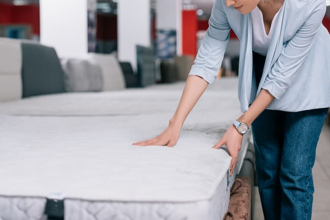 photo of person buying new mattress