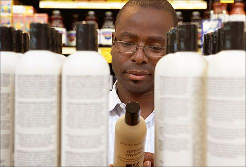 man browsing shampoos