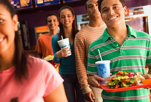 Teen boy opting for salad at fast food place