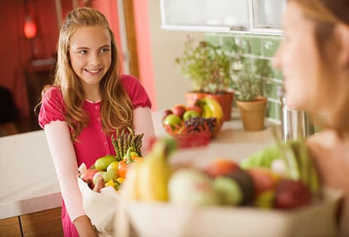 Teen girl talking with mom about healthy food