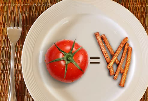 Tomato and pretzels on plate