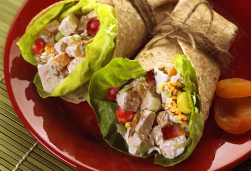 Chicken salad wrap with grapes and apples