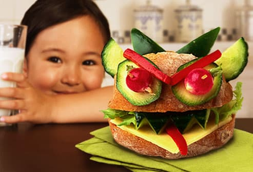 Young girl with creative sandwich