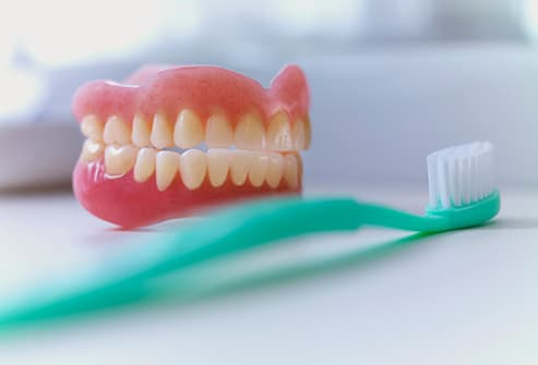 dentures and toothbrush