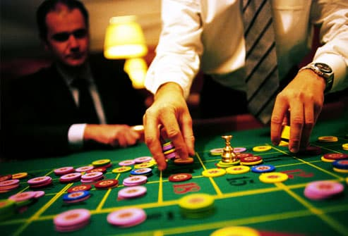 Man and dealer with gambling chips
