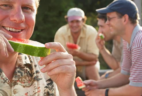 Group of Men Eating Watermelon