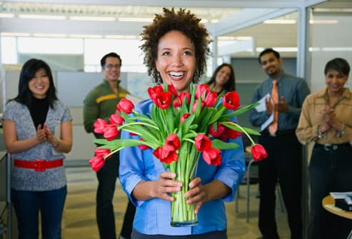Happy Business Woman Holding Flowers