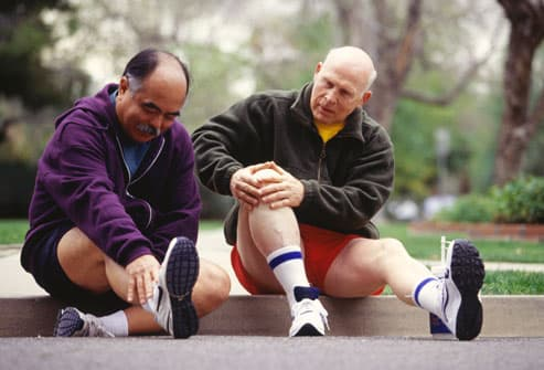 Two Men Resting After Running