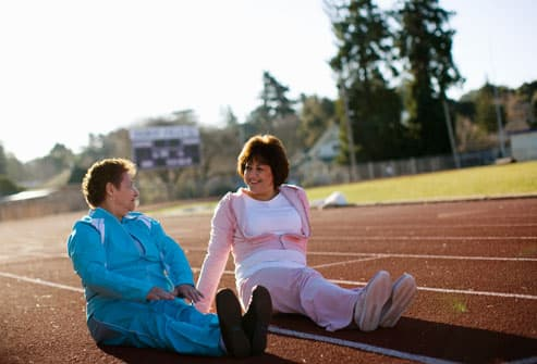 Two Women Resting on Track