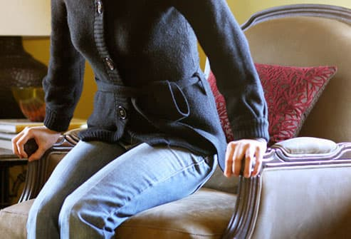 Woman Rising from Chair