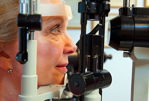 woman taking eye exam