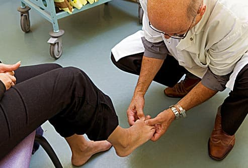 doctor inspecting diabetics foot