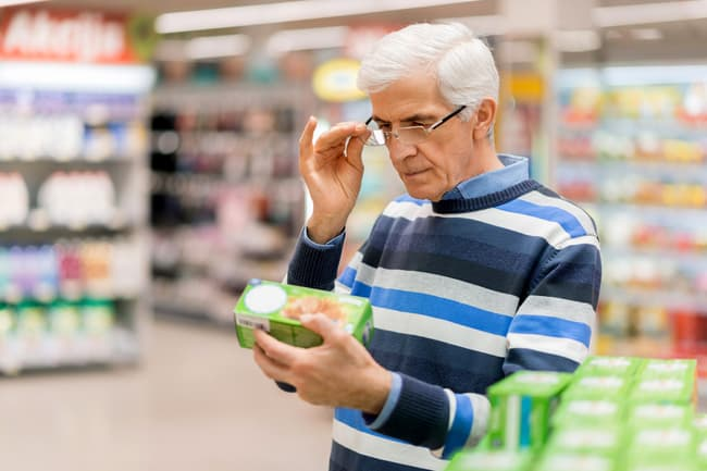 photo of mature man reading label