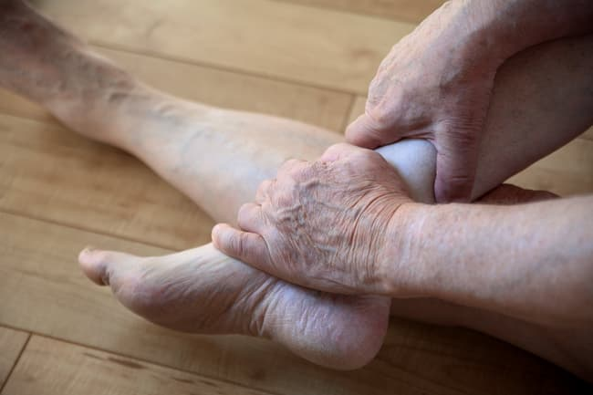 person holding ankle
