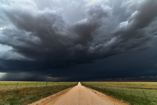 thunderstorm over dirt road