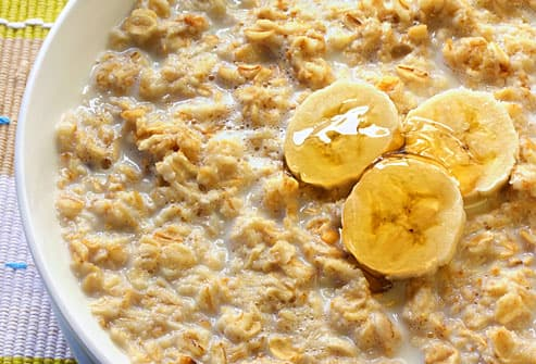 Close up view of oatmeal and bananas