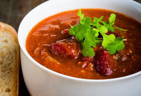 Bowl of chili with cilantro and bread