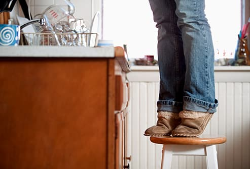 person standing on stool
