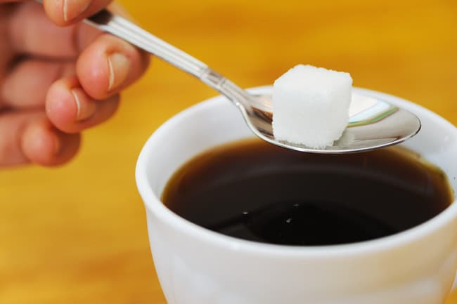 photo of sugar cube by coffee cup